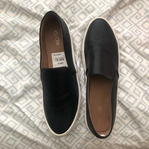 Selling these cute black slip on